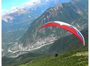 Paragliding toward Bovec valley, Julian Alps, Slovenia
